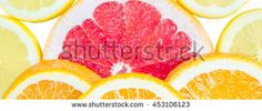Panoramic bright and fresh lemon, orange, grapefruit for skinali. Colorful citrus fruit slices background. White backside.