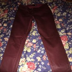 Maroon wax coated power stretch jeans David Kahn wax coated jeans. These are low rise and skinny fit.  Worn only a few times. David Kahn Pants Skinny