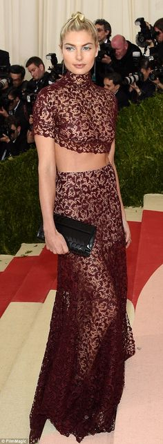 Toned tummy: Aussie beauty Jessica Hart wowed in a maroon lacy two piece...
