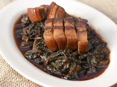 Easy and traditional Hakka recipe for steamed mui choy (preserved mustard greens) with pork belly.