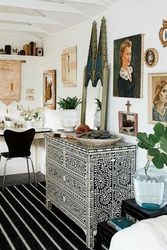 """More from Morse's diverse collection of art and vintage pieces line the walls. """"I like to be surrounded by things that make me happy and have memories attached,"""" she says."""