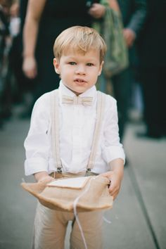 Adorable ring bearer with bow tie! Reminds me of my cousin Peter from my parents' wedding photos!