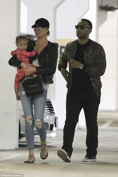 Trio: John Legend and Chrissy Teigen looked stylish as ever as they headed out in Hollywood on Monday, their daughter Luna in tow