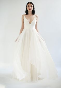 The Gabrielle Dress is an Ivory silk deep V-neck gown with an open back. The fully boned bodice has ...