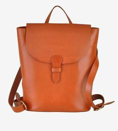 Crafted from a single piece of rich tan leather, this minimalist backpack carries all you need for your daily travels.