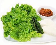 Korean Food | Ssam | Vegetable Leaf Wrap - Ssam refers to various leaf vegetables which are used to wrap a piece of bite-size meat, along with dwenjang, gochujang or ssamjang paste and some rice into a bundle. The vegetables used for wrapping can vary but it primarily consists of fresh red leaf lettuce, sesame leaves, or parboiled cabbage leaves.