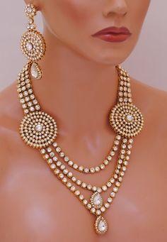 Goldpolish white  kundan set-2050[Regular Price:                                    $190.00                                                                    Now only:                                    $76.00]