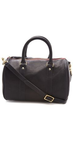 """""""A petite duffel styled in buttery leather lends a touch of casual-chic to any look."""""""