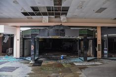 Shattered glass, broken ceiling tiles and pools of dank water cover the floor of Rolling Acres mall