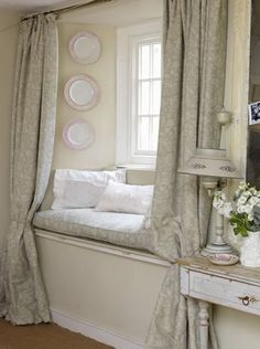 Another idea for our bay window. Curtains in front, shades over windows, pillows on seat.