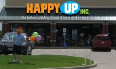 Edwardsville's Grand Opening Hoopla featuring a balloon-wielding chicken.
