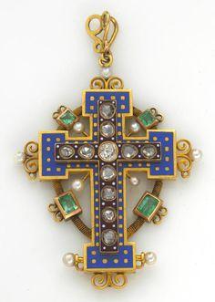 Emerald, diamond and gold cross.