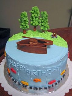 Birthday cake - Cake for my father-in-law's 65th birthday.  Boat, oars, tackle box and fire wood made out of fondant.  (My first time using fondant.)  Trees made from icing and pretzel rods.  Inspiration for cake taken from Wilton yearbook.  Thanks for looking!