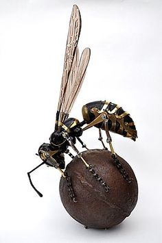Mechanical Wasp on fruit by French sculptor, Edouard Martinet
