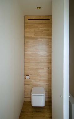 minimalist ½ bath, wood wall modern toilet Appartement M