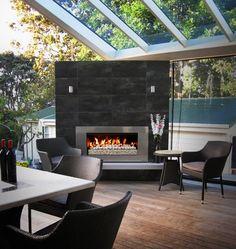 Urban villa extension with ESCEA outdoor fireplace. www.wignells.com.au