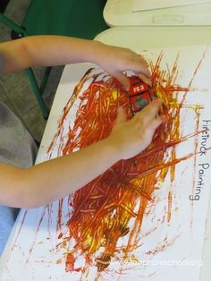 painting with fire trucks or cars to make a fire pattern. More