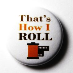 http://www.etsy.com/listing/76728083/thats-how-i-roll-white-button-pin-or?ref=sr_gallery_40_search_submit=_search_query=camera+buttons_view_type=gallery_ship_to=US_page=8_search_type=all_facet=