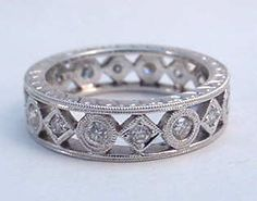 Geometric diamond wedding band with hand engraving