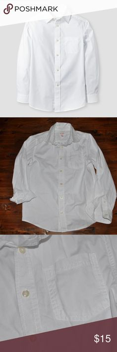 New CAT & JACK Boys White Button Down Dress Shirt Dressy occasions don't have to be a fight - make it cool and comfortable with the Boys' Dress Shirt in White by Cat & Jack. This long-sleeve button-up shirt is durable, dapper and always in style.  size M (8/10) new without tags color: white  Long-sleeve dress shirt Classic details like collar, front placket and cuffed sleeves Front patch pocket  @cjrose25  More kids clothes in my posh closet. Bundle your likes for a discount & save on…