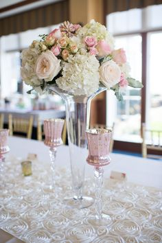 Tall Glass Vases with Spring Bouquets of Roses and Hydrangeas and Pink Glass Candle Holders