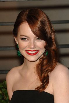 Red Vixen: For the 2010 Vanity Fair Oscar Party, the actress went for a modern take on Old Hollywood glamour with glossy waves and a bright red lip look.
