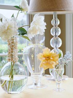 dress up vases with old jewelry or string glass beads onto fishing line & make your own