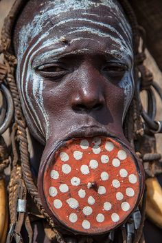 Mursi tribe Lady with traditional lip plate by anthony pappone photographer, via Flickr