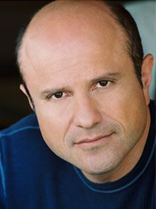 Enrico Colantoni was born (1963) in Toronto, Ontario.  He is an actor, known for portraying Elliot DiMauro in the sitcom Just Shoot Me!, Keith Mars on the TV series Veronica Mars, and Sergeant Greg Parker on the television series Flashpoint. Colantoni currently plays a recurring role on Person of Interest as Elias, an elusive crime boss.