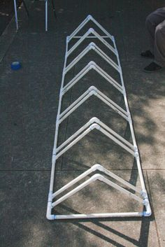 PVC bike rack instructions - mount to the wall instead of floor [avoid tripping hazard in tight space] Pvc Bike Racks, Diy Bike Rack, Bicycle Rack, Bike Stand Diy, Bike Parking Rack, Bike Stands, Bike Storage, Garage Storage, Standing Bike Rack