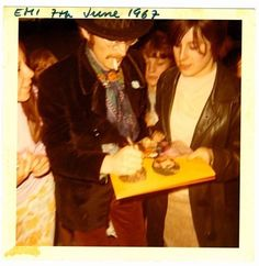 """Signing Sgt Pepper for a fan """" Beatles Art, Beatles Photos, The Beatles, Beatles Sgt Pepper, Surf Music, Photograph Video, 1970s Music, George Martin, Lonely Heart"""