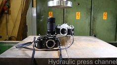 Nikon and Canon put to the ultimate durability test in this hydraulic press