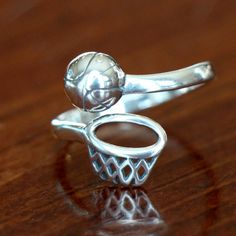 This sterling silver basketball ring is the perfect sports jewelry gift for yourself, basketball player, basketball coach, basketball fan, b...