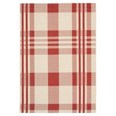 Anchor your dining set or patio seating group in country-chic style with this classic rug, featuring a plaid print in red.   Product: