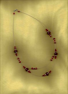 Marooned  Staggered Maroon Crystal Beaded by sunniescustomjewelry, $25.00