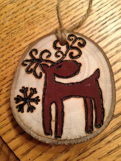 Rustic Reindeer wood burned Christmas ornament - natural wood Christmas Ornament Crafts, Christmas Wood, Primitive Christmas, Christmas Projects, Christmas Tree Ornaments, Holiday Crafts, Christmas Decorations, Wood Slice Crafts, Wood Burning Crafts