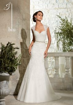 <strong class='info-row'>Mori Lee</strong> <div class='info-row description'>Blu Bridal 5303   Alençon Lace Appliqués on Net</div> <div class='row info-row text-center'> <div class='col-xs-6 col-xs-offset-3'> <a class='image-caption-view-website' href='http://www.morilee.com/bridals/blu/5303' target='_blank'> <div class='view-website'>View Website</div> </a> </div> </div>