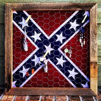 """Gorgeous and tough jewelry display for the cowgirls out there. Using reclaimed wood and classic favorites of chicken wire and the Rebel Flag. Delicate enough looking to go with any decor, but tough enough to hold your favorite cowgirl buckles. Measures approx 19.5""""x19.5"""