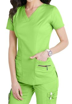 Accents abound on this eco-friendly, figure-flattering and lightweight stretch scrub top! Citrus color is perfect for the season! Healthcare Uniforms, Medical Uniforms, Work Uniforms, Cute Scrubs Uniform, Scrubs Outfit, Stylish Scrubs, Iranian Women Fashion, Scrub Jackets, Medical Scrubs