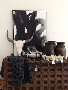 Skull display.  Western decorations cannot live without wooden and leather elements like sofas and chairs,  patterned rugs and fabrics. Transforme your bedroom, living room, kitchen, bathroom and even outdoor and see more home design ideas, here: http://www.pinterest.com/homedsgnideas/