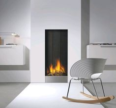 Free-standing Faber fires are the focal point of your home, figuratively and often literally too. Discover here which fire is best suited to your interior-design requirements. Interior Design Requirements, Gas Fireplace, Fireplaces, Fireplace Ideas, Rocking Chair, Accent Chairs, Sweet Home, Home Appliances, Wall Decor