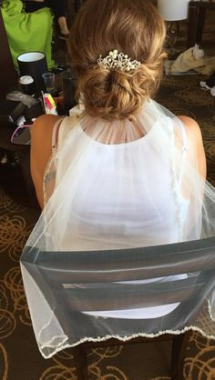 Bridal updo with veil underneath using all redken products