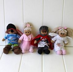 Mini Rag Doll  These beautiful handmade rag dolls come in a variety of cute characters certain to delight your little ones.  The ballerina comes wearing a gorgeous tutu of pink net, a pale pink top and matching shoes. The angel is dressed in a pretty embroidered white dress with pink shoes, pink bows in her hair and angel wings on her back. The pirate certainly looks the part with his stripey top, red bandana, pirate's hat and eye patch and the knight looks very brave in his red cape, smart…