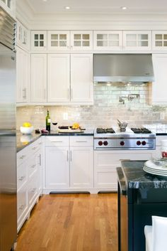 Add glass cabinets to the space above cabinets white shaker kitchen cabinets, glass front cabinets Above Cabinets, Glass Cabinets, Ikea Cabinets, Kitchen Cabinets With Glass Doors On Top, Tall Cabinets, Display Cabinets, Kitchen Upper Cabinets, Above Cabinet Decor, Kitchen Cabinet Sizes
