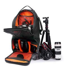 DSLR Camera Backpack Photography Sling Bag, Orange.      Main compartment with dividers - Keep accessories neat, organized and easy to access.     Adjustable shoulder straps - For effective weight distribution.     Side-release buckle strap - Securely holds a compact travel tripod.     Dual mesh pockets - Side pockets hold water bottles or extra accessories.     Handle - Top grab handle, easy to carry with one hand.