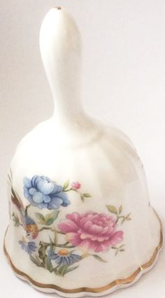 A brilliantly plumed bird amid a display of delicately colored and intricately detailed flowers brings a time-honored motif from old china to this beautiful English bell designed exclusively for the B