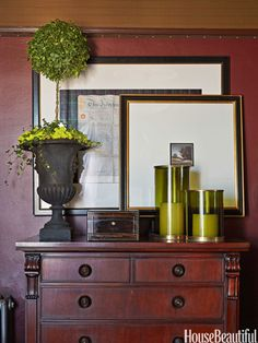 A vignette atop a Ralph Lauren Home dresser in the bedroom epitomizes Wood's penchant for layering art and objects.
