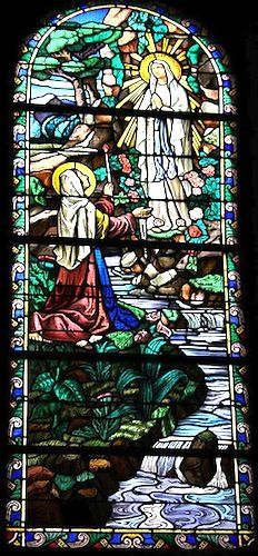 Stained glass window depicting Bernadette's vision at Lourdes. Bernadette's story caused a sensation with the townspeople, who were unsure whether she was telling the truth. But she soon had a large number of people following her on her daily trips to the grotto, some out of curiosity, and others who believed that they were witnessing a miracle