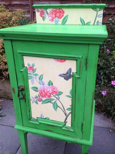 a small cabinet which has been hand painted in Annie Sloan Antibes Green with complementary paper inserts!