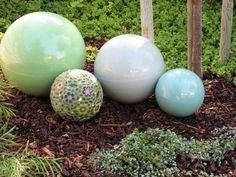 Marvelous Orbs In The Garden   A One Of A Kind Mosaic Orb From Vashon Island, Wash.,  Artist Clare Dohna With 3 Solid Ceramic Garden Balls From Bauer Pottery Of  ...